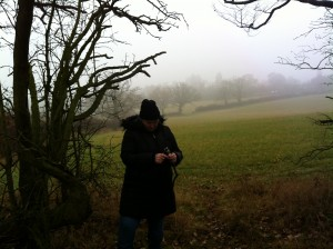 2013-12-12 Hatch End - Sharlene at cache 6.  Sometimes I just get lucky. I knew it was foggy and hoped that the photo would be moody and it was.
